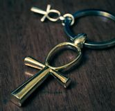 Egyptian Cross Ankh. Egyptian ankh cross on a dark background. Photo toned Stock Image