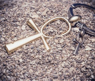 Egyptian Cross Ankh. Large and small Egyptian ankh cross in the sand. Photo toned Royalty Free Stock Photos