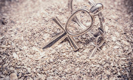 Egyptian Cross Ankh. Large and small Egyptian ankh cross in the sand. Photo toned Stock Photography