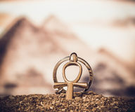 Egyptian Cross Ankh. Large and small Egyptian ankh cross in the sand. Photo toned Stock Images