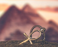 Egyptian Cross Ankh. Large and small Egyptian ankh cross in the sand. Photo toned Royalty Free Stock Photography
