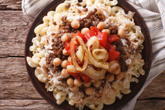 Egyptian Cuisine: kushari close-up on the plate. horizontal top Stock Photos