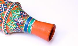 Egyptian decorated orange pottery vase on white background Stock Images
