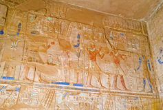 The Egyptian decors. LUXOR, EGYPT - OCTOBER 7, 2014: The reliefs depict the traditional for Egyptian Temples scenes of Pharaohs' life and mythology, on October 7 Royalty Free Stock Image