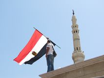 Egyptian demonstrator holding flag Royalty Free Stock Photography