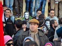 Egyptian demonstrators wearing masks stock image