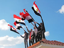 Egyptian demostrators waving flags. February 11, 2011 - Egyptian revolution, demonstrations on Corniche road, Alexandria, Egypt Stock Photo