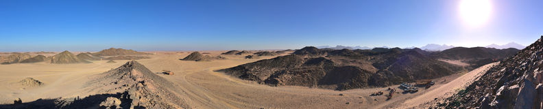 Egyptian desert panorama. On the part of the route quad safari. In the bottom right of apparent preparation for a safari for tourists Royalty Free Stock Photo