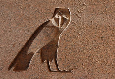 Egyptian Eagle Owl. An Egyptian Hieroglyph in the shape of on eagle owl on an obelisk in the Temple of Amun in Karnak near Luxor (Thebes), Egypt Stock Image