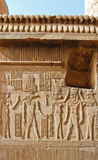 Egyptian engraved gods on wall Stock Photography