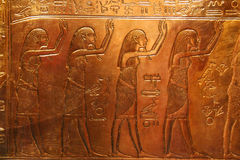 Egyptian engravings. Ancient Egyptian engravings in gold Stock Photos