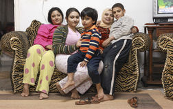 Egyptian family. DAHAB, EGYPT - FEBRUARY 2, 2011: Egyptian family during riots in Cairo. Millions of protesters demanded the overthrow of the regime of Egyptian Royalty Free Stock Photos