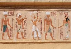 Egyptian figures. Ancient Egyptian figures on a wall Royalty Free Stock Photo
