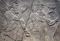 Egyptian figures on stone relief royalty free stock photos