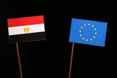 Egyptian flag with European Union EU flag isolated on black. Background Stock Image