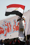 Egyptian Flag - Freedom. A young man waving the Egyptian flag and wrapped in another flag in Tahrir square post the resignation of former President Mubarak Royalty Free Stock Photos