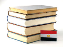 Egyptian flag with pile of books isolated on white background. Egyptian flag with pile of books isolated on white Stock Image