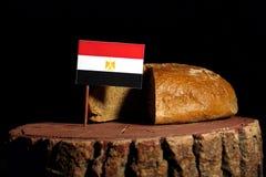 Egyptian flag on a stump with bread royalty free stock photos