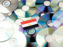 Egyptian flag on top of CD and DVD pile isolated on white. Egyptian flag on top of CD and DVD pile isolated Stock Photo