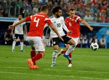 Egyptian football star Mohamed Salah against Russian players Den royalty free stock image