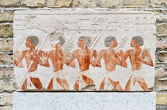 Egyptian fresco. With terracotta men with cereals and instruments Royalty Free Stock Photos
