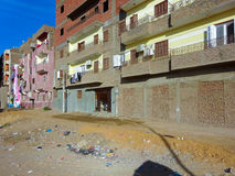 Egyptian ghetto, view to the street where trashes lying on the f. Loor Stock Images