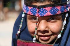 Egyptian girl. DAHAB, EGYPT - JANUARY 24, 2011: Egyptian girl posing on January 24, 2011 in Dahab, Egypt. She wears a a burqa with traditional ornaments Royalty Free Stock Photography