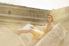 Egyptian. Girl lies on the ruins of an oasis in the desert Royalty Free Stock Photos