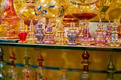 Egyptian glass in Khan El Khalili Bazaar, Cairo, Egypt. The beautiful perfume bottles of Egyptian glass in stall of Khan El Khalili Bazaar, Cairo, Egypt stock photography