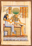 Egyptian God Horus on papyrus. Ancient Egyptian God Horus with Queen Cleopatra hand painting on papyrus Stock Photos