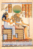 Egyptian God Horus on papyrus. Ancient Egyptian God Horus with Queen Cleopatra hand painting on papyrus stock photo