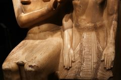 Egyptian god with pharaoh statue, Luxor Museum stock photography