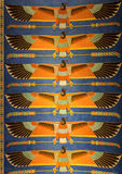 Egyptian goddess bird painting. On the wall Stock Photos