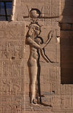 Egyptian Goddess Isis. A bas-relief on Temple of Isis on the Philae Island near Aswan, Egypt Stock Photos