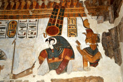 Egyptian Gods. Beautiful ancient egyptian relief painting of the solar war god Montu with his stunning consort Rettawy in Luxor in Egypt Stock Image