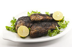 Egyptian Grilled Tilapia. A Plate of Egyptian Grilled Tilapia Stock Photography