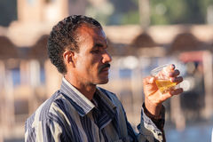 Egyptian guide drinking tea in Cairo, Egypt Royalty Free Stock Photography