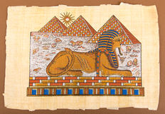Egyptian hand pyramids and sphinx  on papyrus. Ancient Egyptian hand pyramids and sphinx  on papyrus Stock Photo