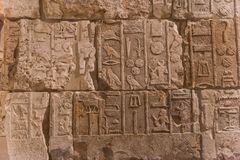 Egyptian hieroglyph`s character`s on stone stock images