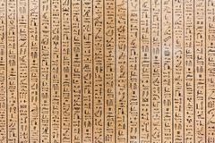 Egyptian hieroglyph`s character`s on stone royalty free stock photos