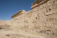 Egyptian hieroglyphic carvings on a temple wall Stock Image