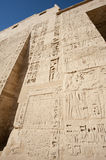 Egyptian hieroglyphic carvings on a temple wall Royalty Free Stock Photos