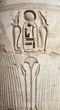 Egyptian hieroglyphic carvings on a temple wall Royalty Free Stock Photo