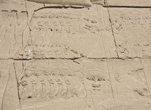 Egyptian hieroglyphic carvings on wall Stock Photography