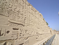 Egyptian hieroglyphic carvings on a wall Stock Photography