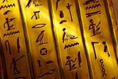 Egyptian Hieroglyphics. Close up shot of Egyptian hieroglyphics carved into stone with shaft of light