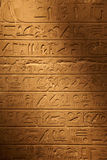 Egyptian hieroglyphics. On the stone wall Royalty Free Stock Photo