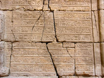Egyptian hieroglyphics. Antique Egyptian hieroglyphics carved on stone wall in Karnak Temple. Luxor, Egypt Stock Images