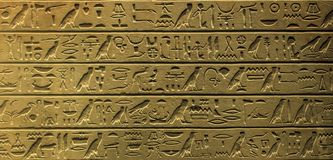 Egyptian hieroglyphics. Close up detail view at egyptian hieroglyphics Royalty Free Stock Photo