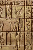 Egyptian hieroglyphics goddess Hathor. Egyptian hieroglyphics Hathor was the daughter of Ra and the patron goddess of women Stock Image